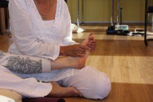 Postnatal support helpers practice massage techniques.