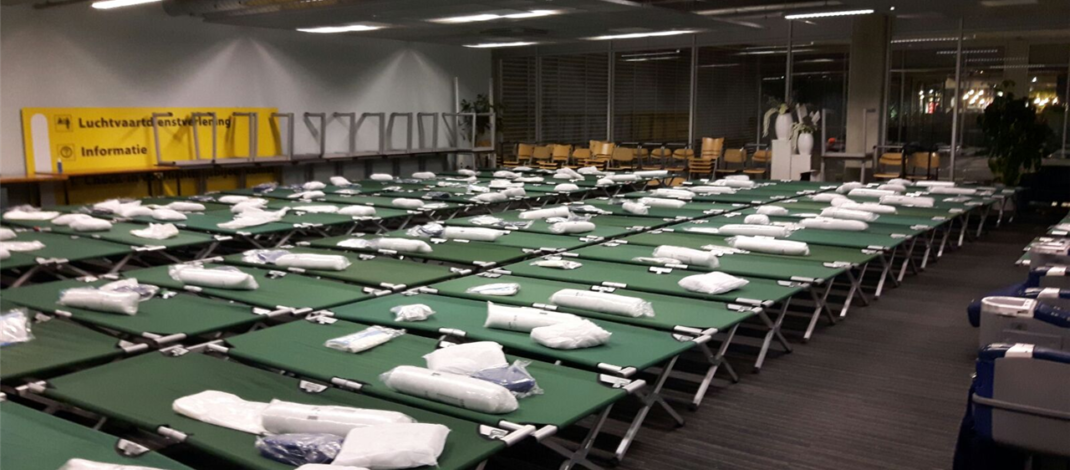 Hundreds of Red Cross camp-beds for stranded travelers Eindhoven Airport